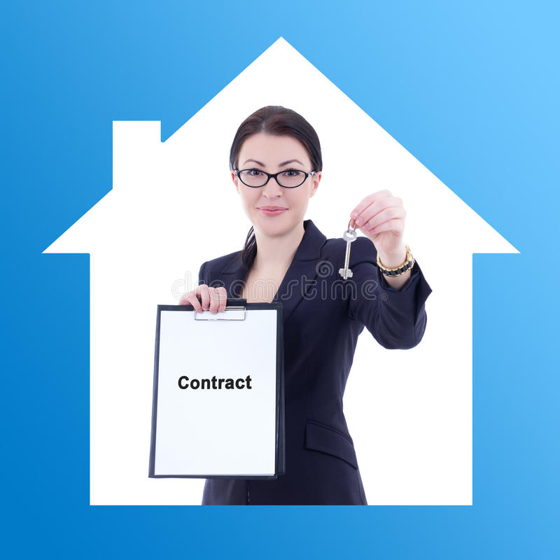 Business woman real estate agent showing contract and metal key royalty free stock photography