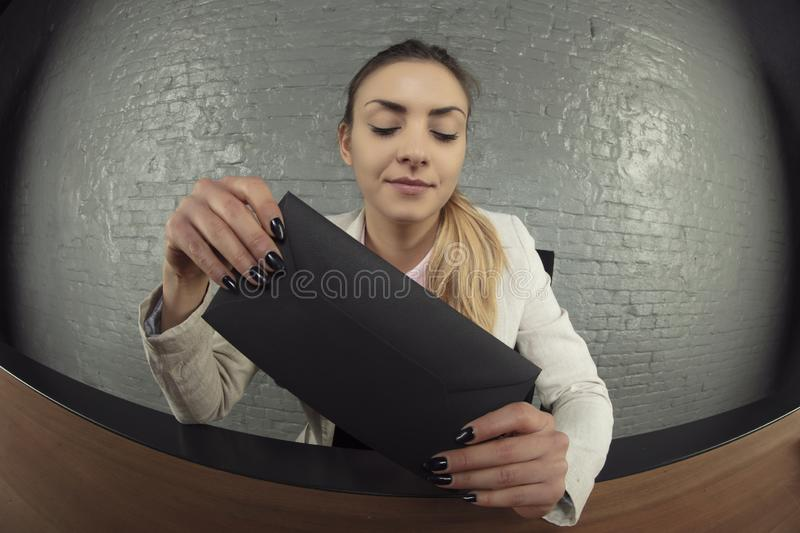 Business woman received a black envelope as a gift, the concept. Of a bribe stock photo