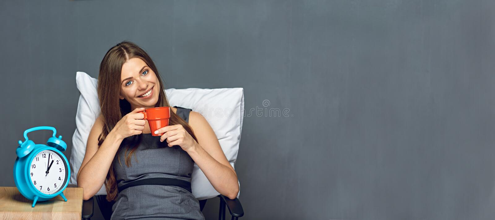 Business woman relax in office with coffee cup. Smile with teeth royalty free stock photo