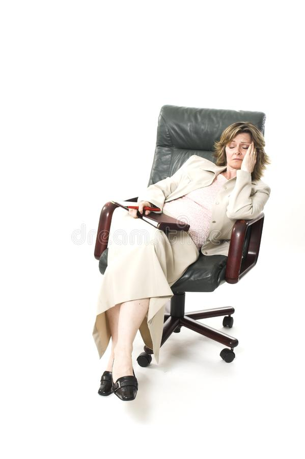 Business woman relaxing on chair stock photography