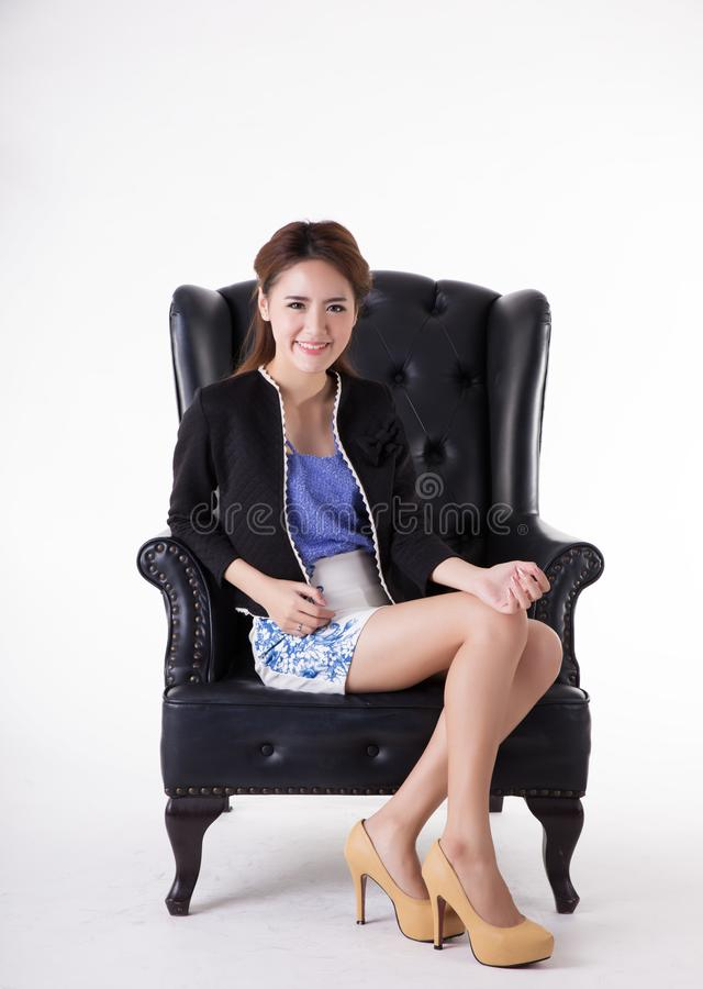 Business woman relaxing in a chair royalty free stock image