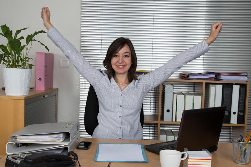Business woman relaxing with her hands up royalty free stock photos