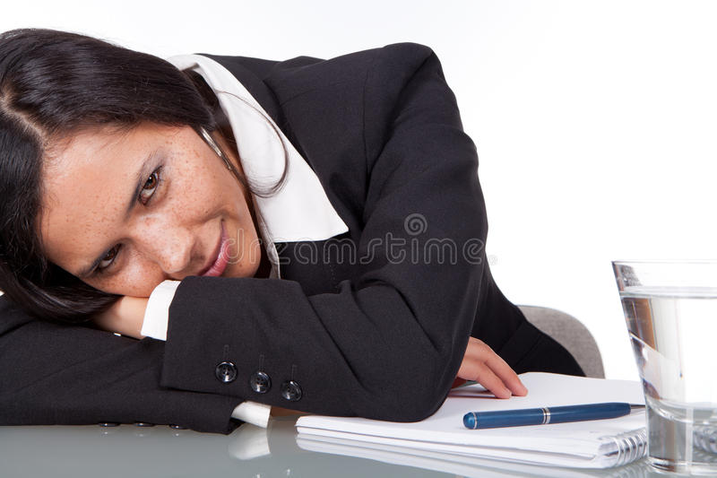Business woman resting on her desk royalty free stock photography
