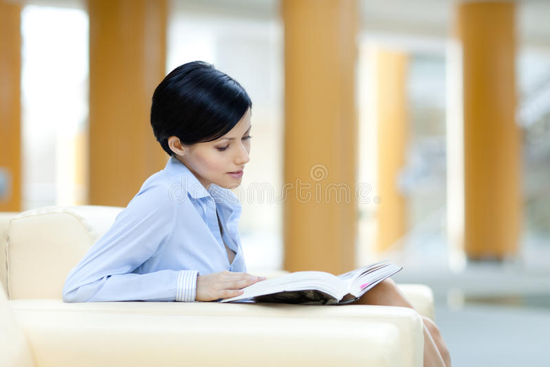 Download Business Woman Rests At The Sofa With Book Stock Photo - Image of insight, building: 26983930
