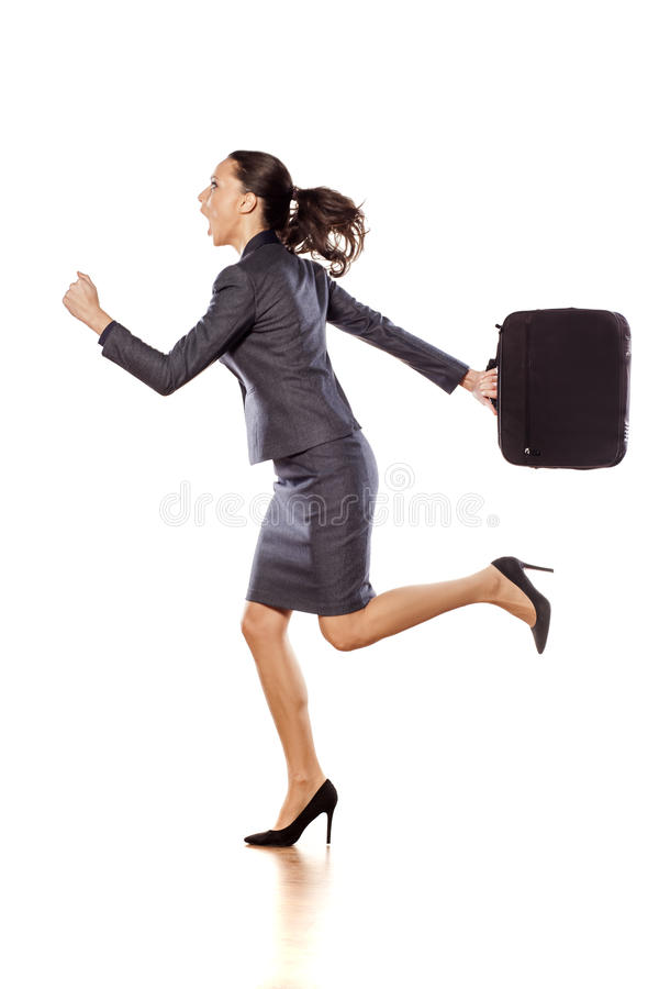 Business woman running. Excited business woman holding a briefcase, running and shouting stock images
