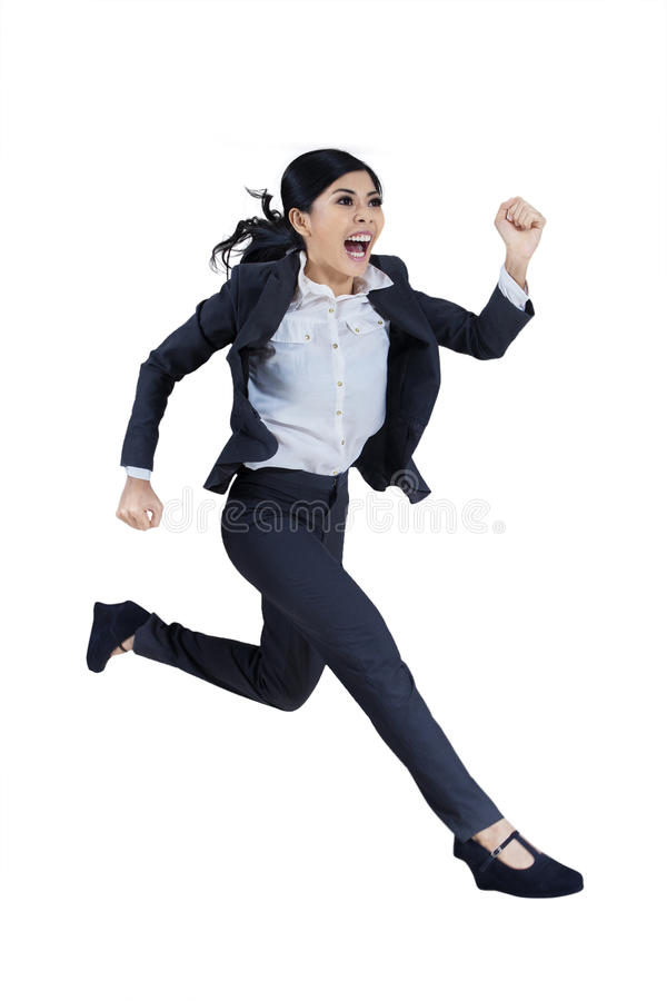 Business woman running in suit stock photography