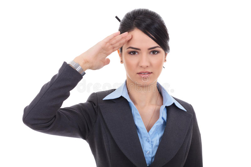 Business woman saluting. Attractive business woman saluting over white background stock photos
