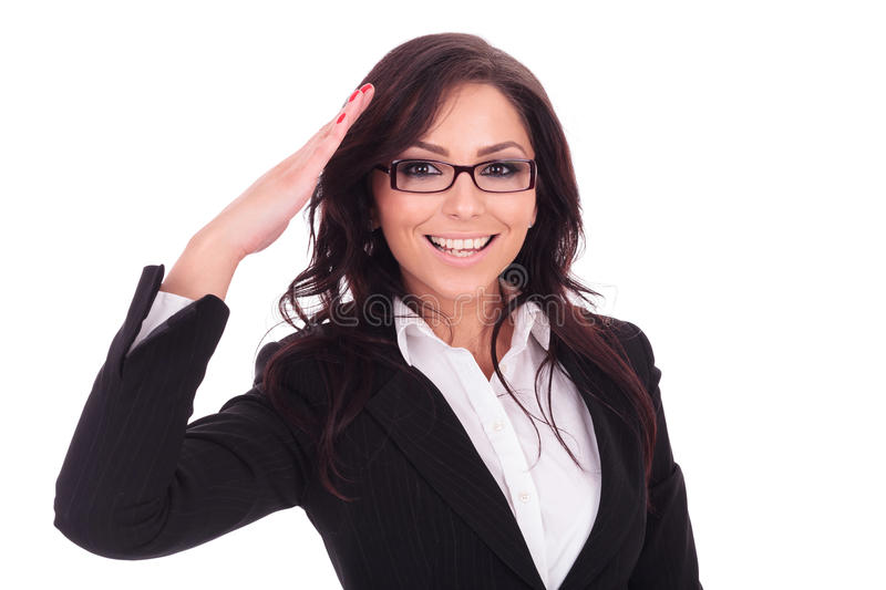 Business woman saluting. Young business woman saluting you in a military style. on white background royalty free stock photos