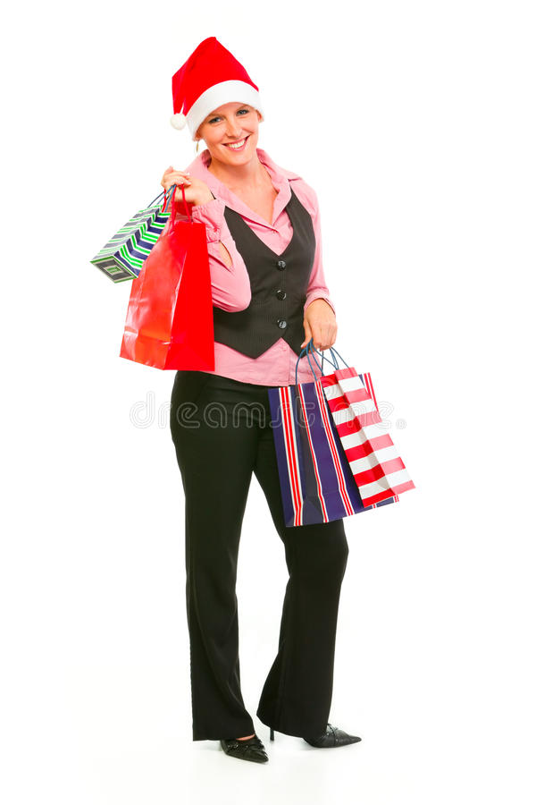 Download Business Woman In Santa Hat Holding Shopping Bags Stock Photo - Image: 21814744