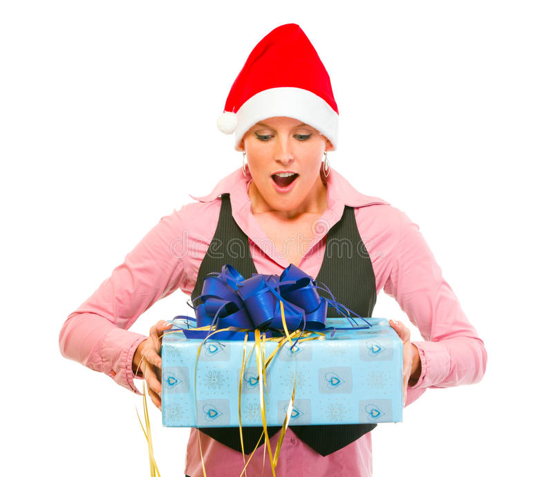 Business woman in Santa Hat looking on gift royalty free stock photography