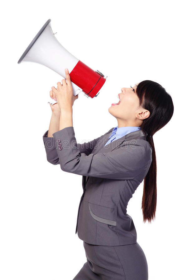 Business woman screaming in megaphone. Business woman screaming loudly in a megaphone (face in profile) isolated on white background, model is a asian beauty royalty free stock photo