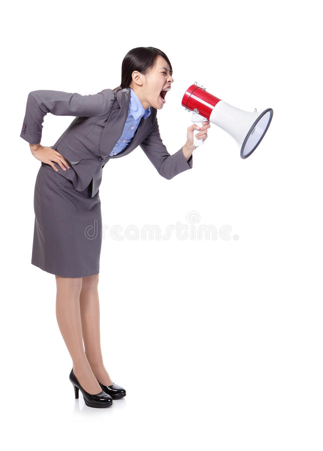 Business woman screaming in megaphone. Business woman screaming with a megaphone to copy space in full length isolated on white background, model is a asian royalty free stock photo