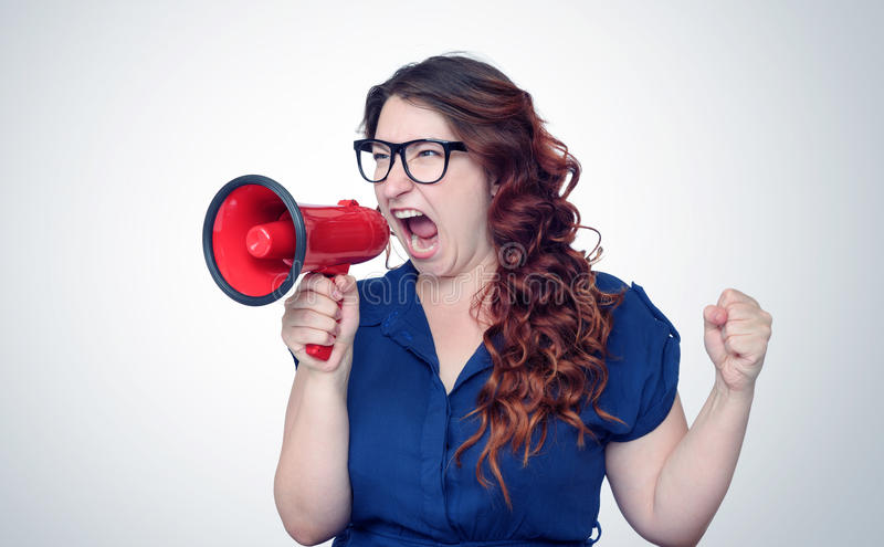 Business woman screaming into a megaphone royalty free stock photos