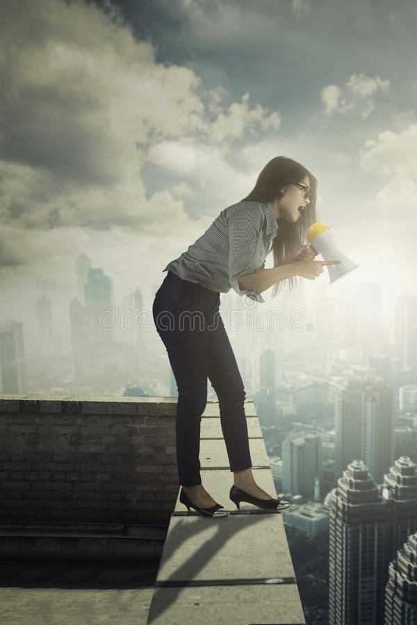 Business woman screaming on the rooftop royalty free stock photos