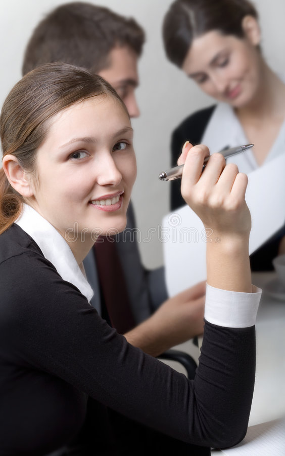 Business woman or secretary and business person working at o. Business woman or secretary and two business person working at office stock photo