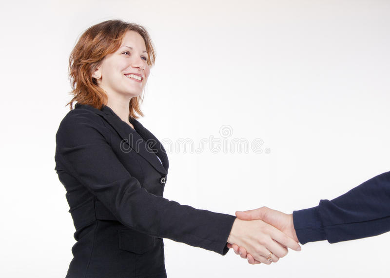 Business woman shaking hands with a colleague stock images