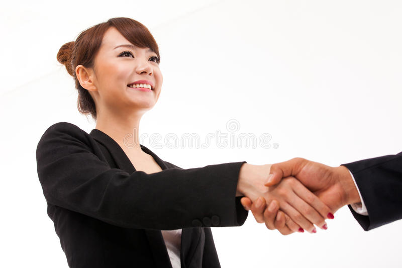 Business woman shaking with someone. stock photo