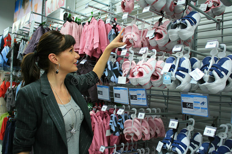 Business woman shopping. For baby shoes in a store royalty free stock photos