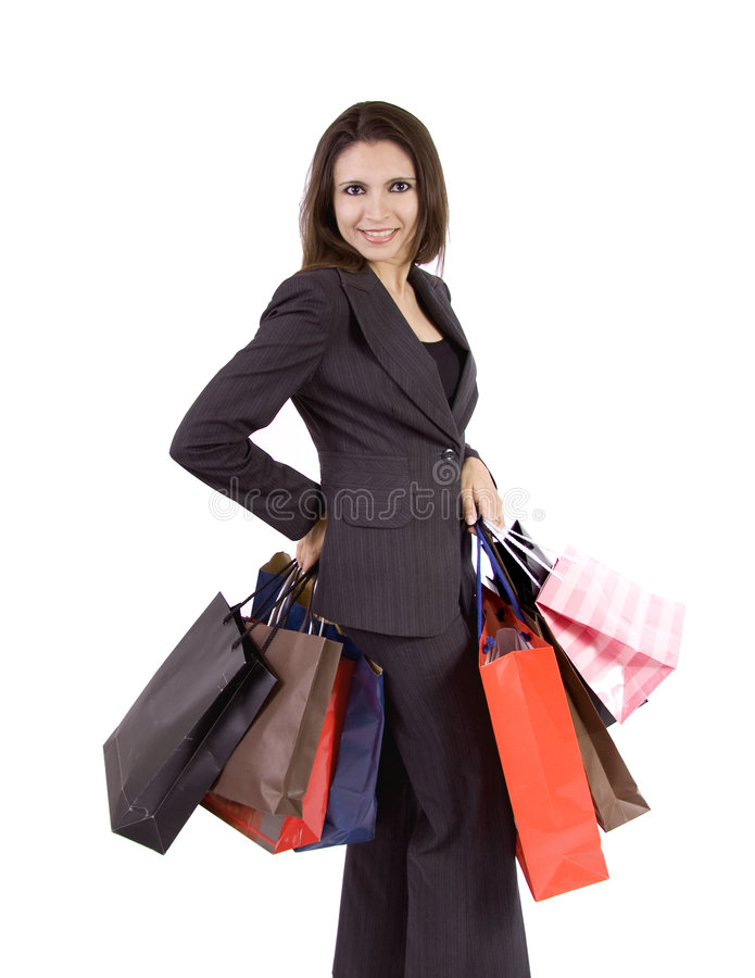 Business woman after shopping. A business woman with a lot of shopping bags royalty free stock photography