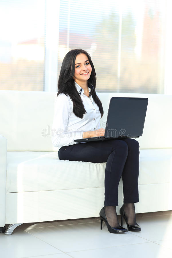 Business woman showing blank laptop. Business woman showing blank black laptop royalty free stock photos