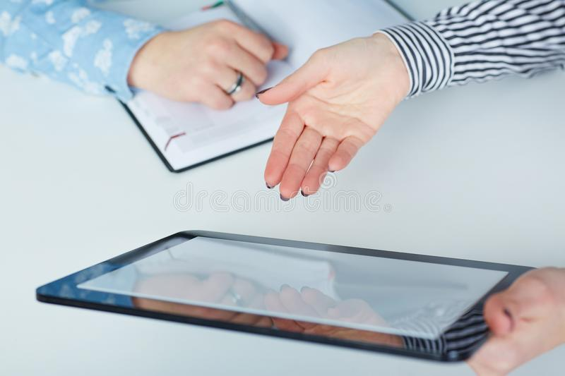 Business woman showing blank no-name tablet pc monitor with copyspace area for slogan or text message stock photo