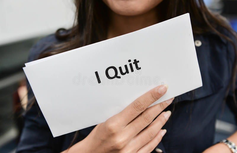 Business woman is showing the document for resignation. I Quit - Business woman is showing the document for resignation for quit the job stock photos