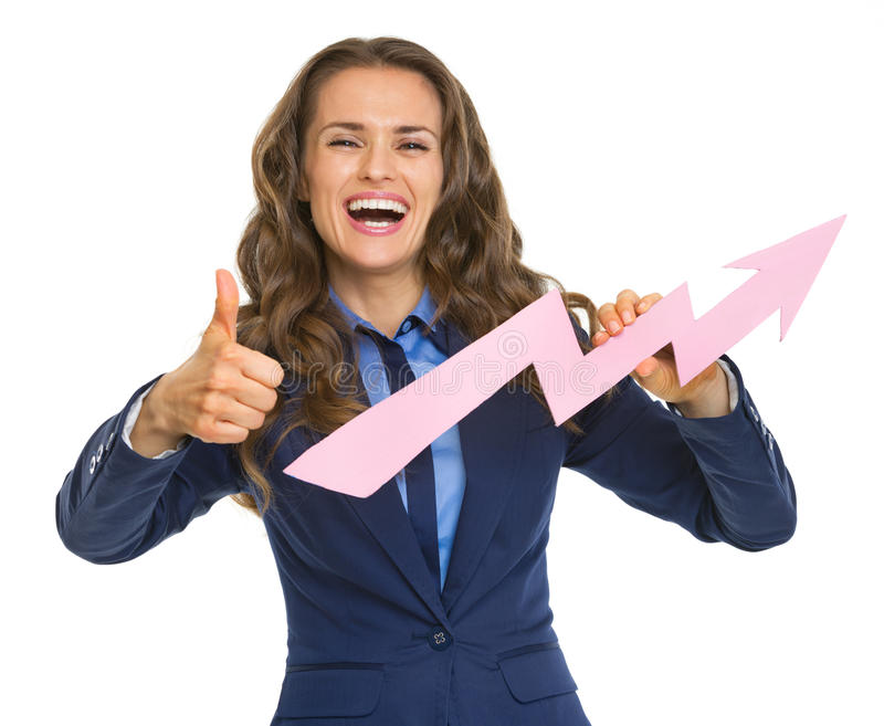 Business woman showing graph arrow going up and thumbs up. Smiling business woman showing graph arrow going up and thumbs up stock photos