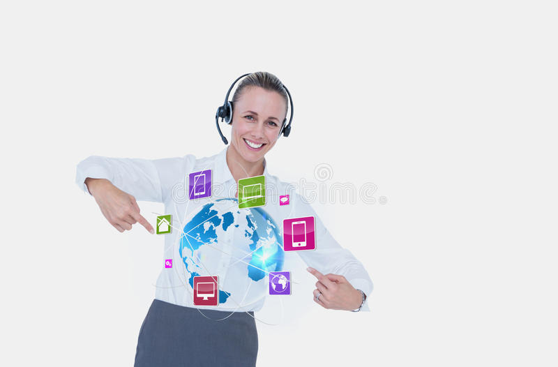 Business woman showing icons and wearing Headset. Digital composite of Business woman showing icons and wearing Headset stock photos