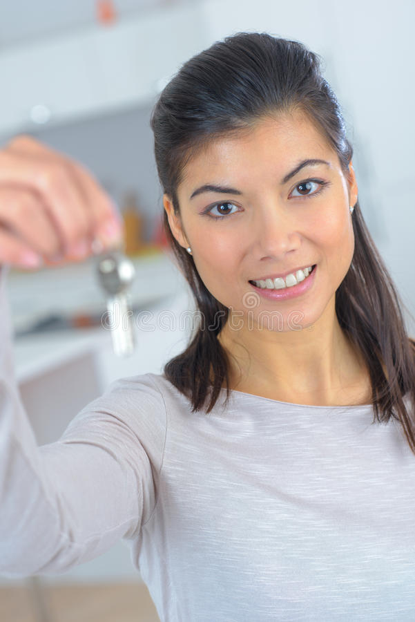 Business woman showing key for home for sale stock photography