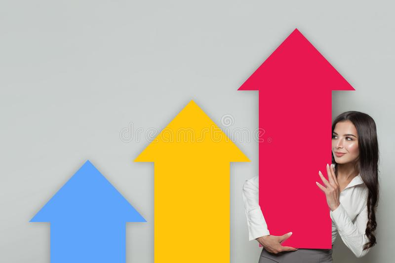 Business Woman Showing Rising Arrow Columns, Representing Business Growth. Business Success and Shares Up Concept.  stock photos
