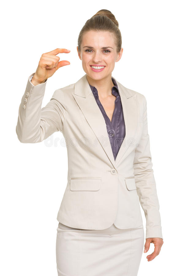 Business woman showing small risk gesture. Isolated on white stock photography