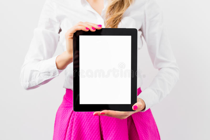 Business woman showing tablet computer vertically. On white background royalty free stock photography