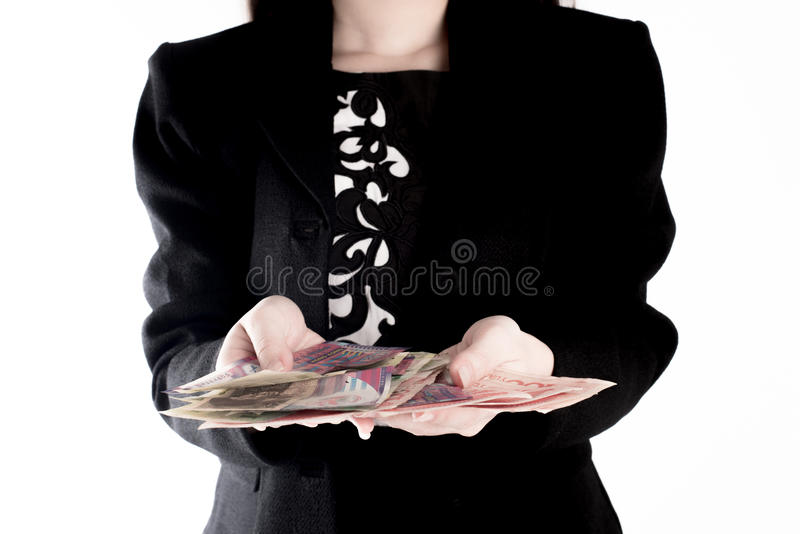 The business woman shows the money. Investment concept royalty free stock photo