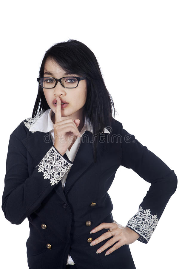Business woman shows silence sign royalty free stock photography