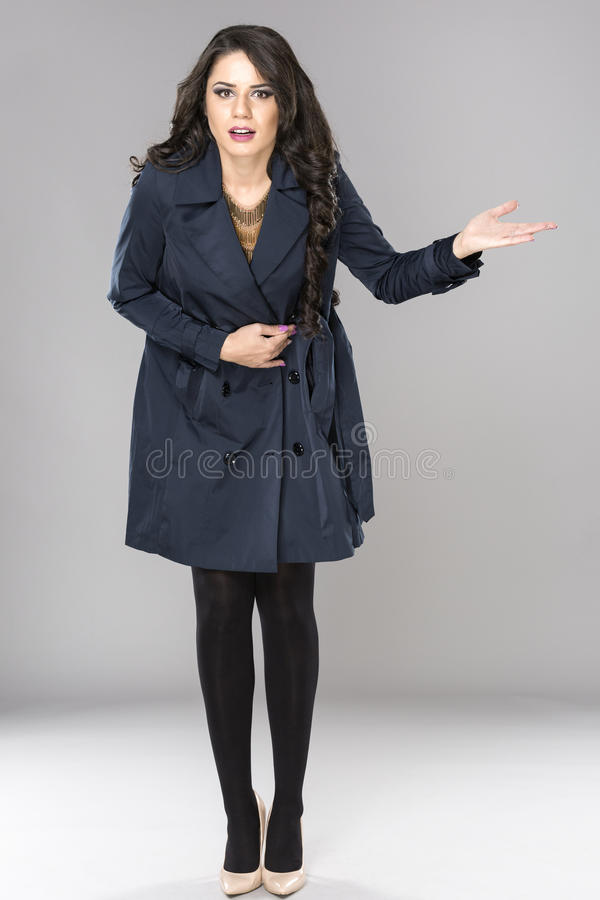 Business woman shrugging with I don't know gesture, isolated on royalty free stock images