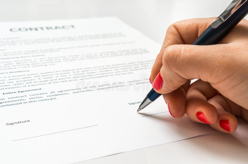 Business woman signing contract document in office royalty free stock image