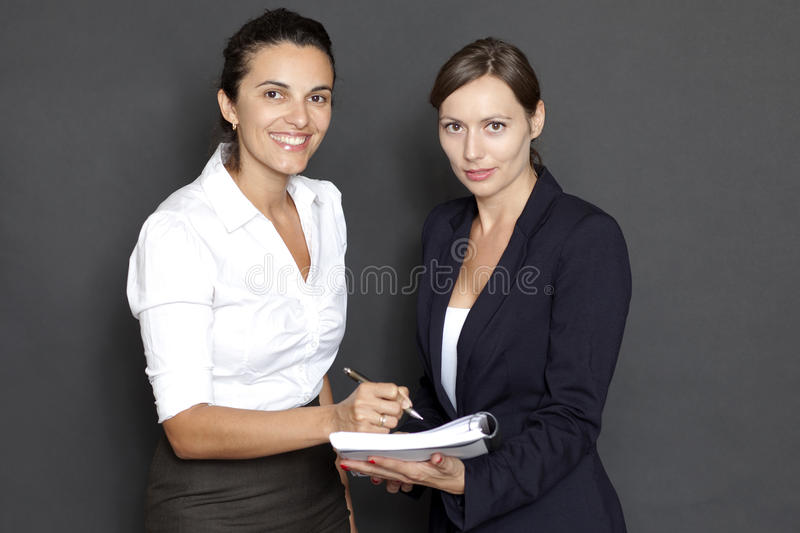 Download Business Woman Signing Documents Stock Photo - Image: 23737336