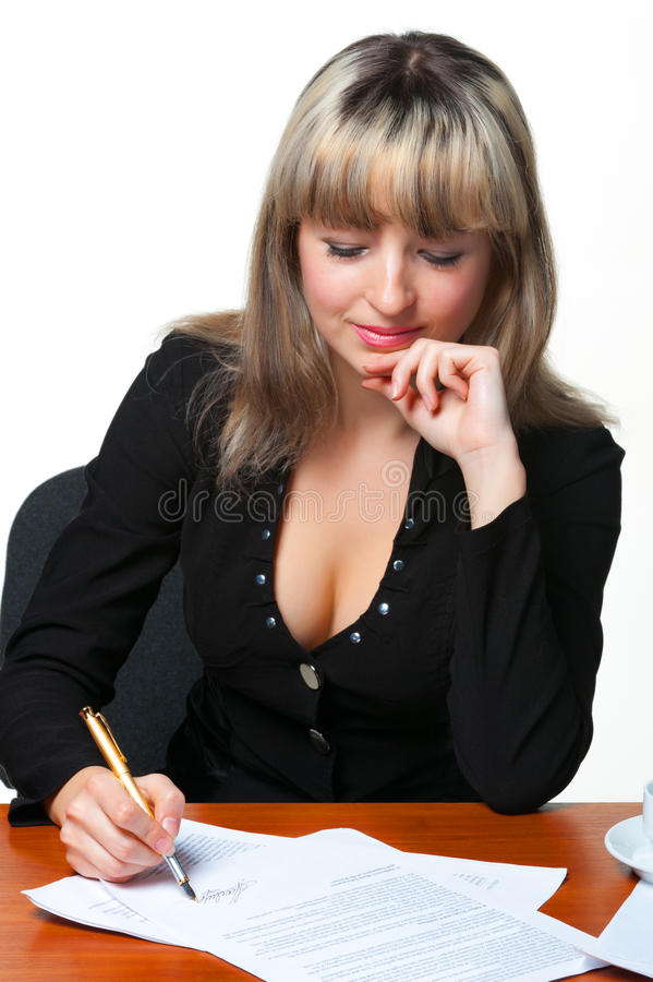 The Business Woman Signs The Contract Stock Photography