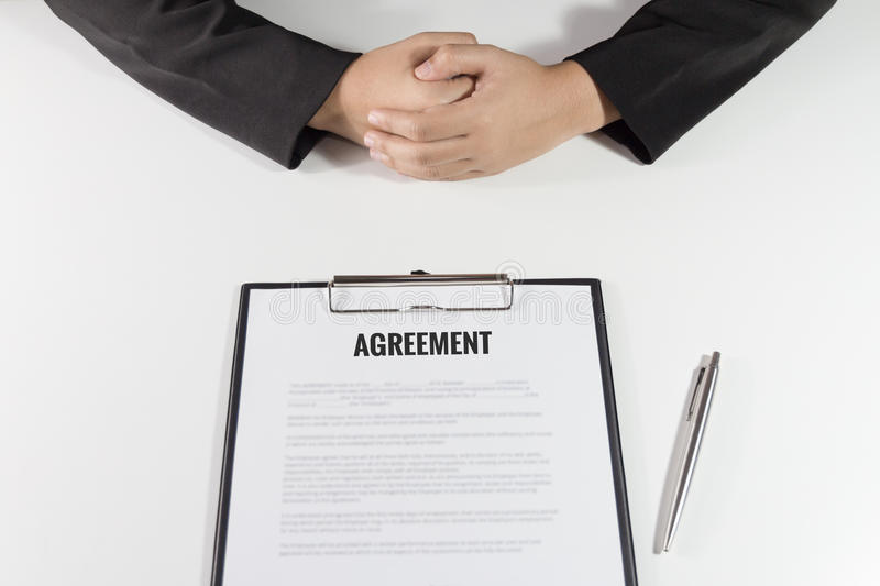 Business Woman sitting with agreement in front of her.  royalty free stock photo