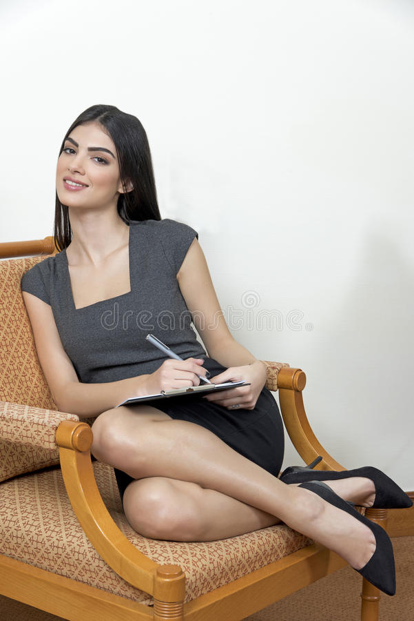 Business woman sitting on an arm chair. royalty free stock photo