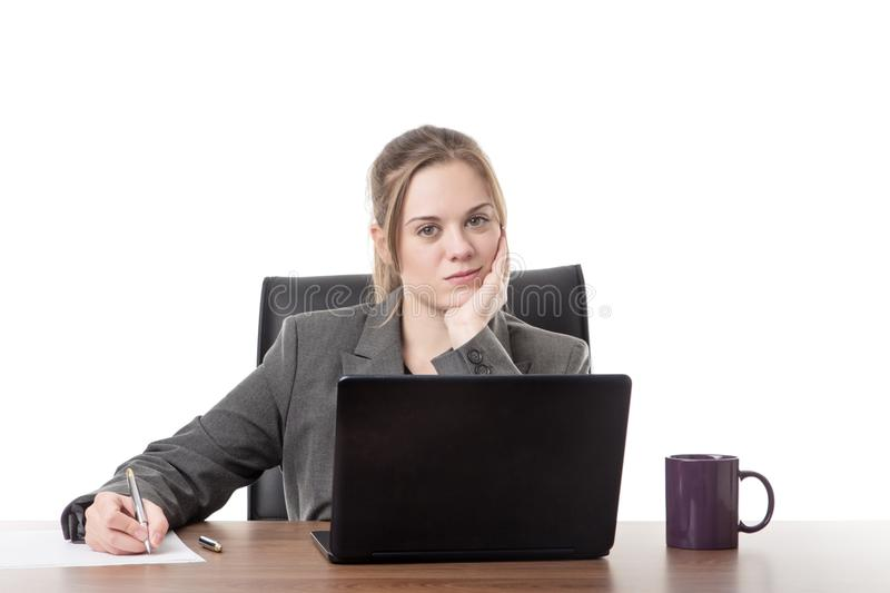 Young business woman sitting a her desk royalty free stock image