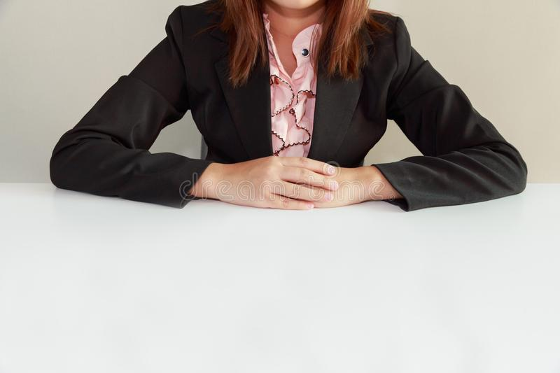 Business woman sitting at desk and waiting for interviewer - int stock images