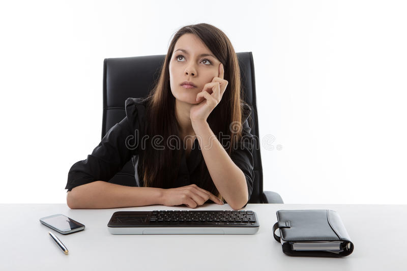 Business woman sitting at her desk royalty free stock photos