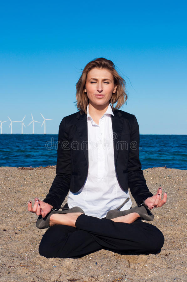 Download Business Woman Sitting In Lotus Pose On The Beach Stock Image - Image: 13369759