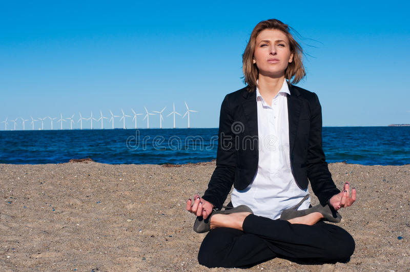 Download Business Woman Sitting In Lotus Pose On The Beach, Stock Image - Image of ocean, smile: 13369793