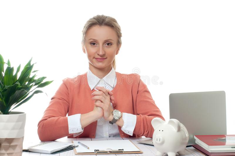 Business woman sitting at the table in office stock photos