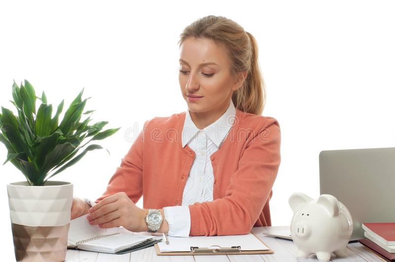 Business woman sitting at the table in office stock photo