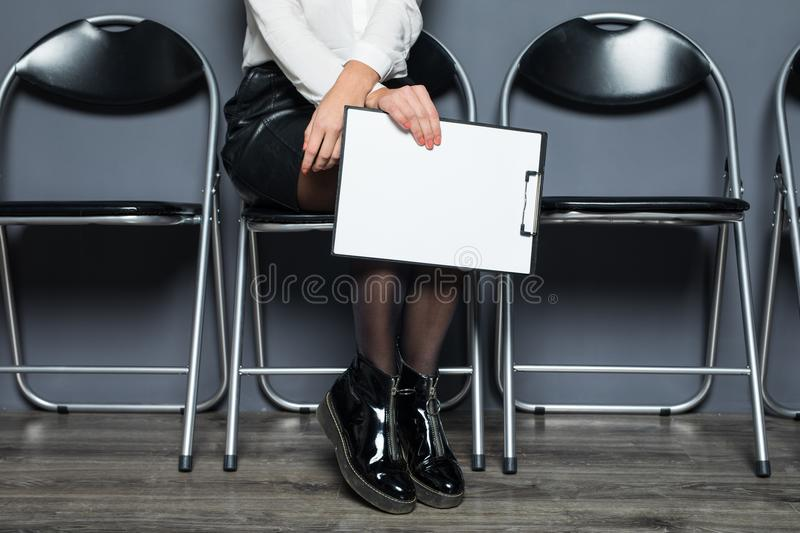 Business woman sitting and waiting for interview in office, business concept royalty free stock photography