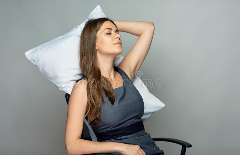 Business woman sleep in office chair. stock photo