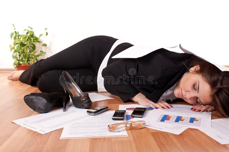 Business woman sleeping on floor stock photography
